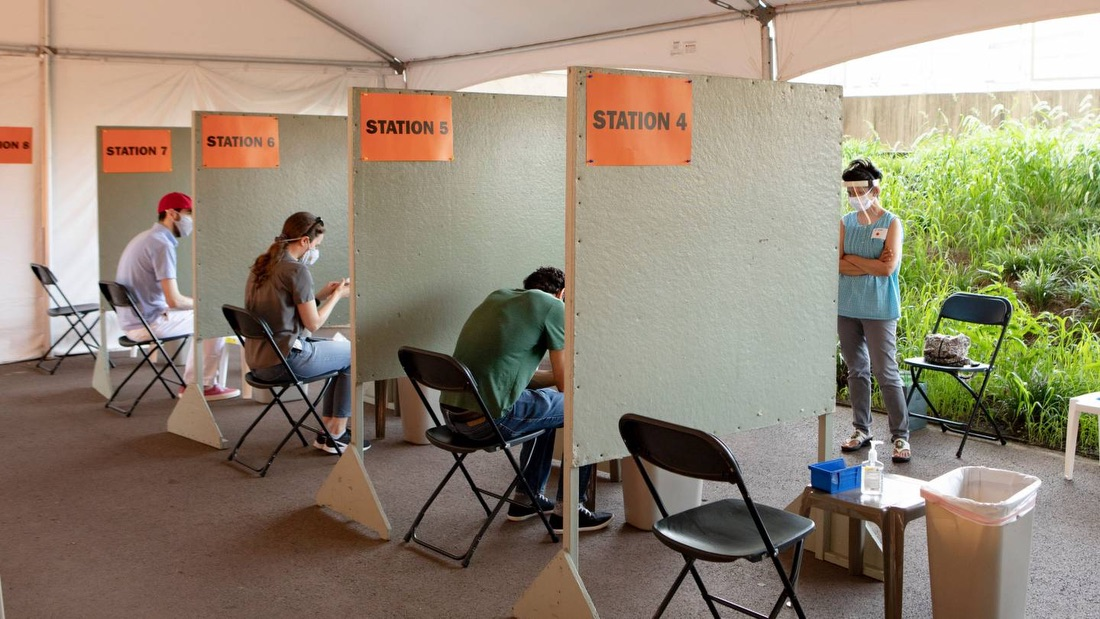 Photo showing asymptomatic Covid-19 testing taking place outdoors at Princeton University Stadium Concourse in a clinic set up with appropriate social distancing and public health protocols.