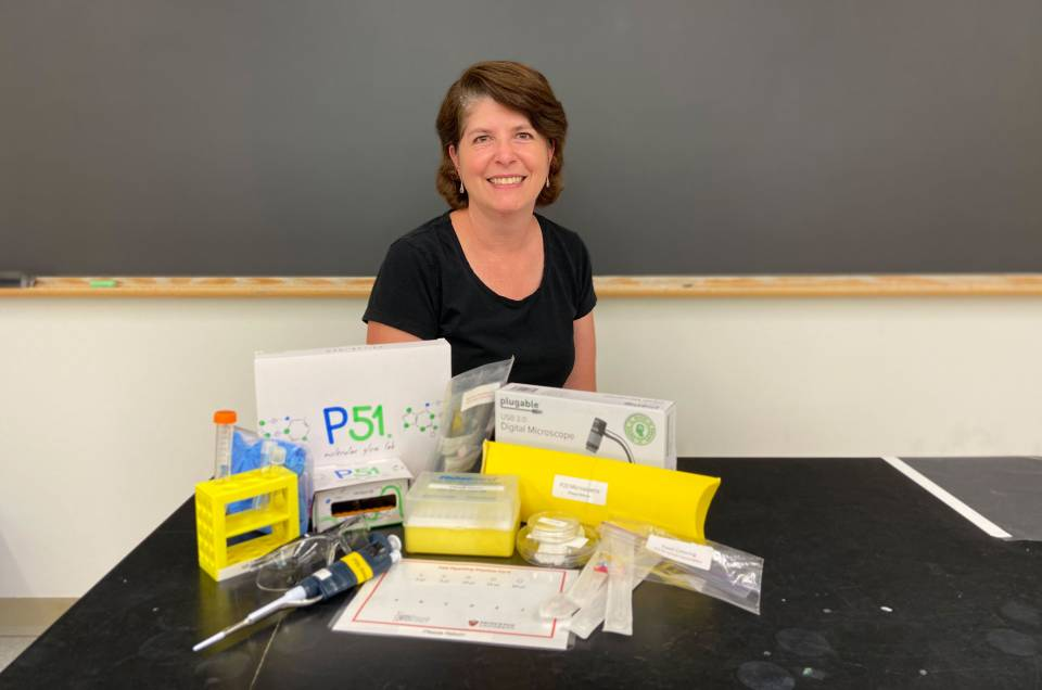 Heather Thieringer, senior lecturer in molecular biology, with science kits ready to be sent to Princeton students for at-home experiments.